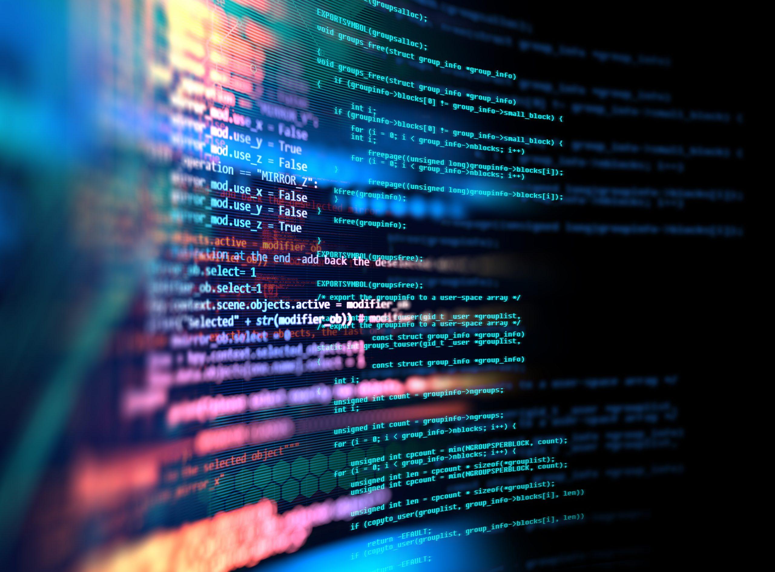 Abstrakte Programmiersprache CSS bunt auf schwarzem Computermonitor